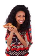 Young black african american teenage girl eating a slice of pizza - african p Stock Photos