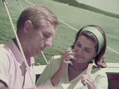 Man and Woman Smoking Cigarettes On a Boat.  1960's Stock Footage