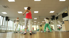 Fitness in aerobics class Stock Footage