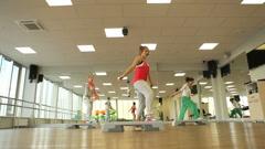Fitness in aerobics class Stock Footage