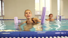 Exercise in swimming pool Stock Footage