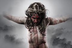 Representation of jesus christ on the cross on cloud background Stock Photos