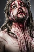 Jesus christ with crown of thorns white on the cross, easter in spain Stock Photos