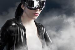 female pilot goggles era aircraft - stock photo