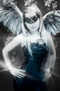 Beautiful young blond woman with mask, sensual and sexy winged representation Stock Photos