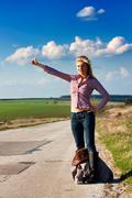 Travel  woman hitchhiking Stock Photos