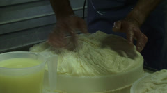 Cheese maker transfers curd mass in cheese mold + whey Stock Footage