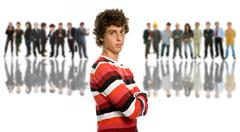 Young man in front of a group of people, isolated Stock Photos