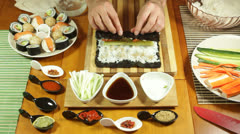 Rolling vegetarian Sushi roll Stock Footage