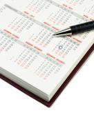 Kalenteri ja kynä Kuvituskuvat