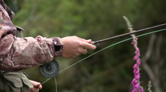Fisherman flyfishing with fly rod. Stock Footage