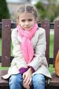 happy little girl in autunm park - stock photo