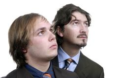 two young business men portrait on white. focus on the left man - stock photo