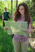 hiker is reading a map - stock photo