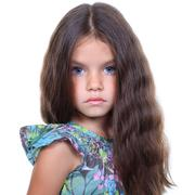 Cute little girl on a white background Stock Photos