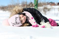 beautiful little girl in winter park - stock photo