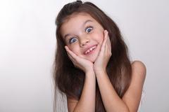 Portrait of a little amazing girl Stock Photos