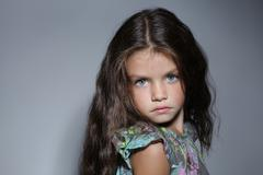 Close up portrait of young beautiful little girl with dark hair Stock Photos