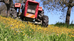 A tractor cuts the grass Stock Footage