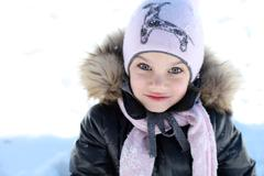 beautiful little girl in winter park - stock photo