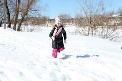 Beautiful little girl in winter park Stock Photos