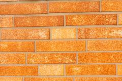 Fake ocher brick wall siding Stock Photos