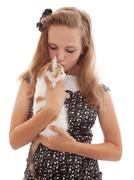 portrait of the young beautiful girl with a kitten - stock photo