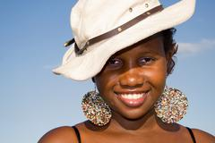 Beautiful african woman with hat Stock Photos