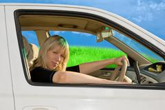 young woman driving - stock photo