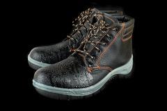 moist modern working boots - stock photo