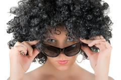 Frizzy woman with sunglasses Stock Photos