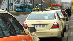 Taxi queue up at Taxi stand waiting passengers Frankfurt Germany Stock Footage