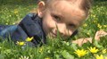 Child Playing with Grass on Meadow, Girl Looking at Flowers in Park, Children Footage