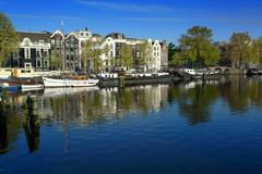 Amsterdam houseboats on amstel Stock Photos