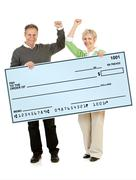 Couple: holding up a blank check Stock Photos