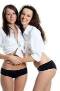couple women in white sexy shirt - stock photo