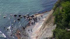 People walking on beach Stock Footage