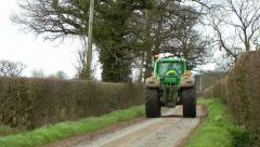 Agricultural Tractor on Country Lane Stock Footage
