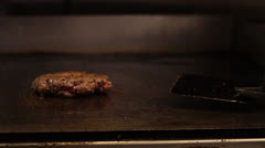 Burger Flipped and Grilled Stock Footage