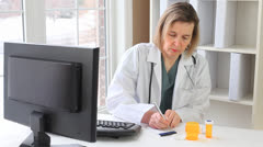 Doctor Writing Perscription Stock Footage