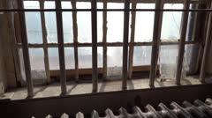 Panning Shot of Sunlit Prison Window - stock footage