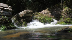 Water rushing over rocks - stock footage