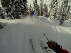POV Heliskiing follow skier Stock Footage