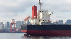 Bulk Carrier Ship Anchored in City Harbour Stock Footage