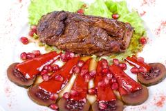 Beef steak with pomegranate Stock Photos