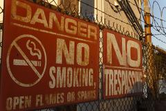 No Smoking No Trespassing Signs - stock photo