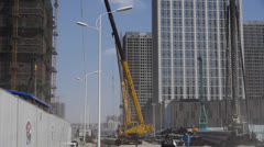High crane & builder working in Construction site. Stock Footage