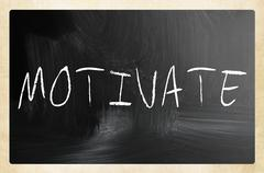 """motivate"" handwritten with white chalk on a blackboard Stock Illustration"