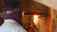 Stock Video Footage of Welder in shipbuilding