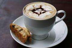 Stock Photo of delicious cappuccino with star design.